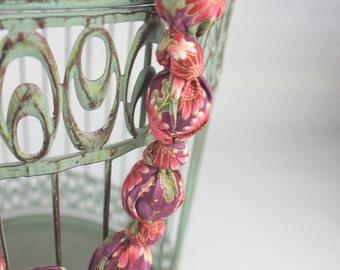 Fabric covered bead necklace, Plum asian blossom designed Hanemai cotton fabric