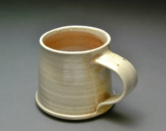 Unglazed Cute and Small Wood Fired Coffee or Tea Mug with Orange and Brown Flame Marks and Fly Ash