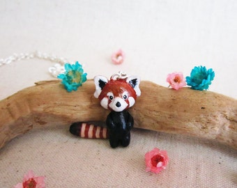Tiny baby red panda necklace with dangling tail.