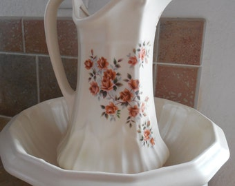 Beautiful pitcher with wash basin, lovely sienna colored painted roses.