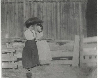 Old Photo 2 Women Sitting on Fence under Umbrella Long Skirt and Dress Shadow 1910s Photograph snapshot vintage