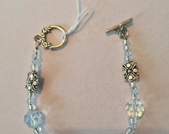 Silver & Crystal bracelet with toggle closure.