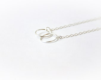 Silver bracelet with linked rings