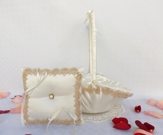 Ivory satin wedding ring pillow and flower girl basket decorated with gold guipure lace.