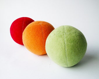 Set of 3 handmade 2.5inch juggling balls with packaging and instructions in red, orange&green monocolored