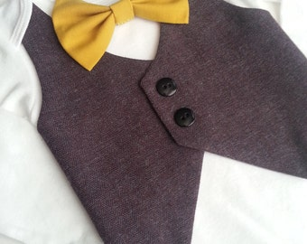 Baby Boy Bodysuit With A Dark Purple Vest Attached And A Mustard Yellow  Bow tie.