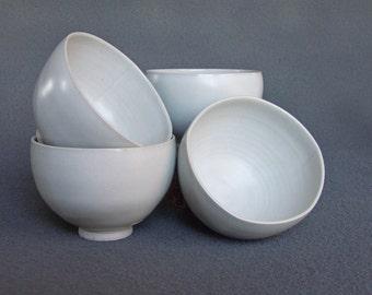 Set of four stoneware tea bowls, hand thrown in white stoneware.