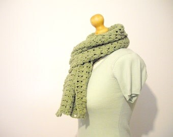 green crochet scarf worked with acrylic wool in lace style