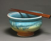 Rice or noodle bowl with chopsticks, matte turquoise and rust glazes