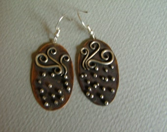 Earrings:Copper and Sterling Silver earrings with swirls and faux granulation.