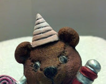New Year's Ceramic Bear with Wine Bottle, Hat, and Noise Maker
