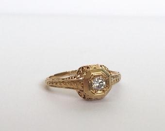 Vintage 18K yellow gold diamond ring, intricately detailed