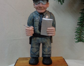 Police officer wood sculpture hand carved wood policeman caricature that is great gift for policeman by Dan Easley