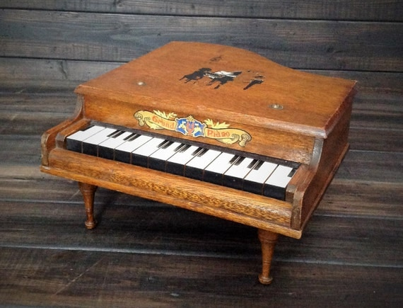 Reserved Vintage Wooden Baby Grand Piano by Misinterpreted