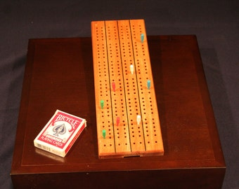 Solid mahogany 2 or 4 player cribbage board with peg storage