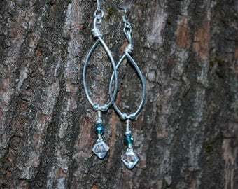 Beautiful yet affordable swarvoski crystal, sterling silver plated hand bent wire and glass beads