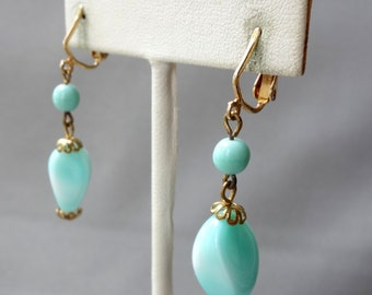 Vintage gold tone dangle earrings with mint blown glass beads, clip on