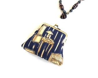 Navy gold clutch purse black antique furniture chair dresser kisslock stripe dark blue vintage gift for antique lover lamp table yellow old
