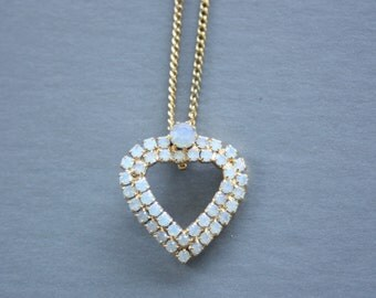 Heart necklace with milky rhinestones. Vintage