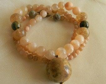 Scrimshaw antler bead pendant w large sun stone beads necklace , beaded jewelry , antler bead w flowers , antler jewelry , sun stone jewelry
