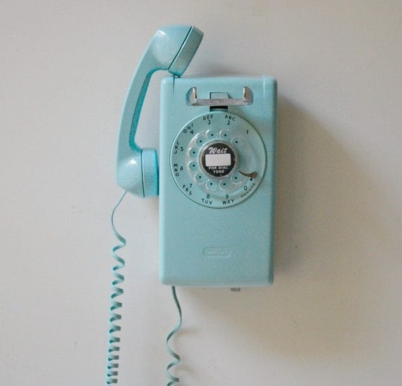 Old fashioned wall mounted telephones 4