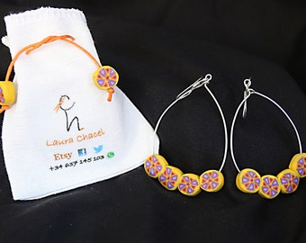 Hoops earrings with silver and four circular beads