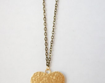 Long necklace with brass heart pendant