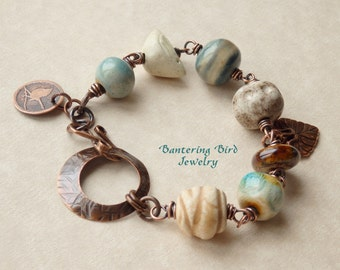 Artisan Ceramic Beaded Bracelet in Ivory, Blue, Brown with Bird Bead Bantering Bird Charm Bracelet Etched Copper Unique Jewelry Gift for Her