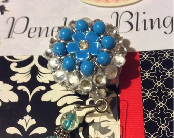 Turquoise flower retractable badge holder