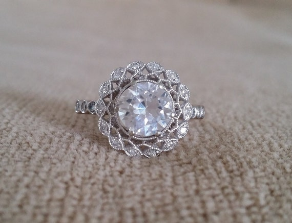 halo white sapphire ballerina antique engagement ring