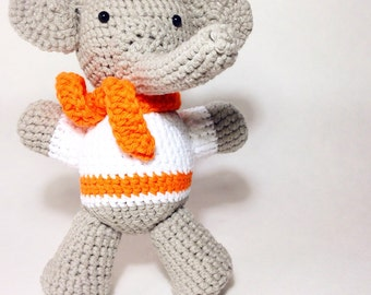 Crochet amigurumi elephant toy with scarf