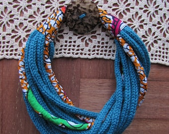 Woolen torchon necklace green oil with African fabric inserts . Unique, original gift idea!