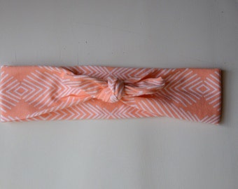 Orange peach with white design retro knot headband for babies or toddlers