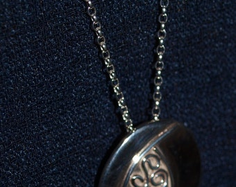 Solid sterling silver hand made convex oval pendant with wire filigree leaf