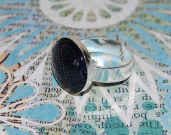 Adjustable ring in blue jeans