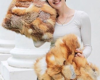 Two red fox fur pillows
