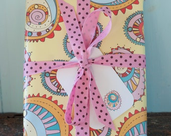 A wrapping paper sheet of multicoloured, bright, patterned gift wrapping paper with or without a matching gift tag by Gabriella Buckingham