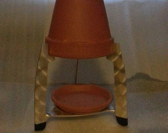 6 inch Flower Pot Heater. Ready to place one or more candles under it and light.