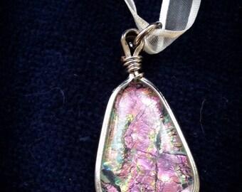 Iridescent resin filled pendant