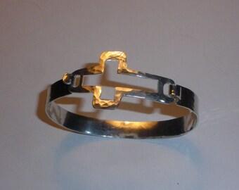 Hammerd sterling silver cut-out cross bracelet.