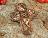 Homemade cross decorated with Easter egg shell