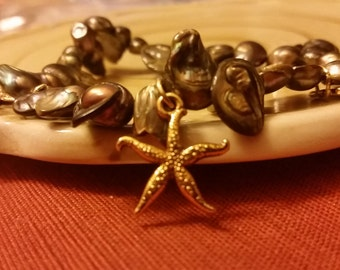 pearl bracelet, with starfish charms