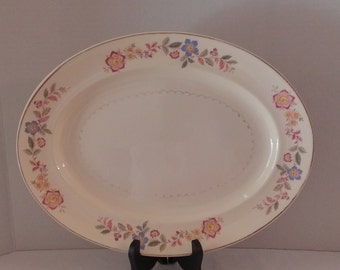 vintage platter Paden City Pottery. Blue, red, and yellow flowers with gold trim.