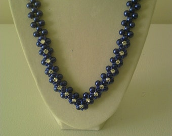 Glass pearl necklace with montee embellishments.