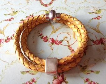 Metalic yellow braided leather bracelet