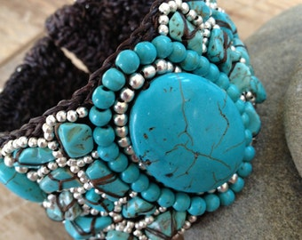 Handmade beaded bracelet with turquoise and silver stone beads