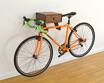 The Clifton Bike Rack - Stylish wall mount indoor bike shelf in walnut with drawer for accessories and bike gear. On sale! Regular Price 475