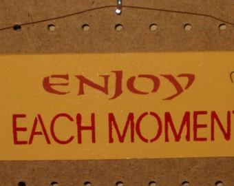 Enjoy Each Moment sign