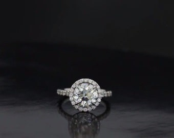 Our Petite Flower Split Shank Halo Engagement Ring
