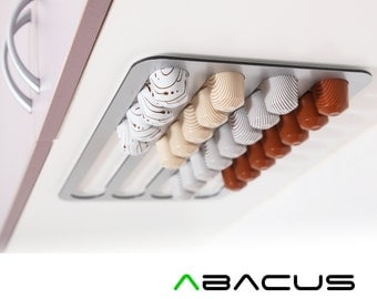 Abacus Pod Rack, a kitchen accessory that holds and dispenses your Nespresso coffee capsules FNS36